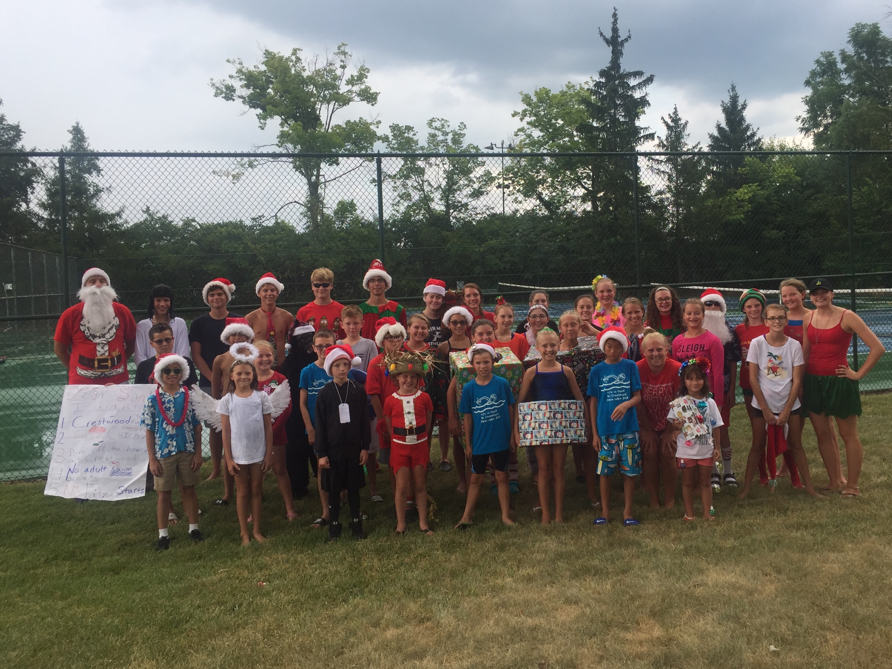 The swim team is dressed for Christmas in July and ready for Finals